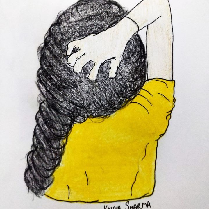 A girl holding the back of her head
