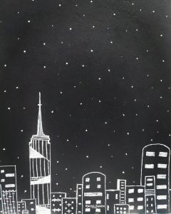 Buildings, dark sky with stars